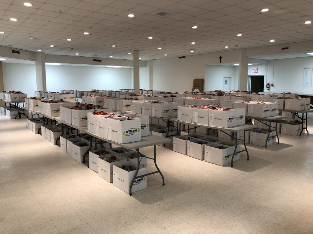 Photo of packed Christmas hampers on tables